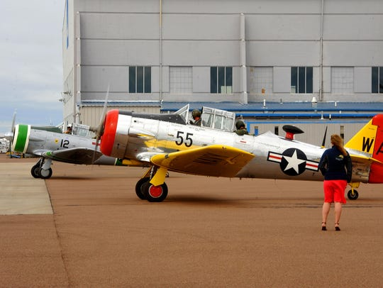 Two T-6 Texans from the Bravo 369 Flight Foundation