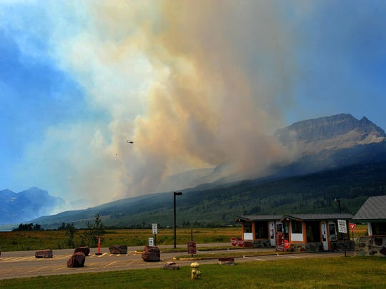 Glacier National Park's St. Mary entrance remains closed Thursday as wildland firefighters battle the Reynolds Creek fire by ground and air on the north shore of St. Mary Lake.