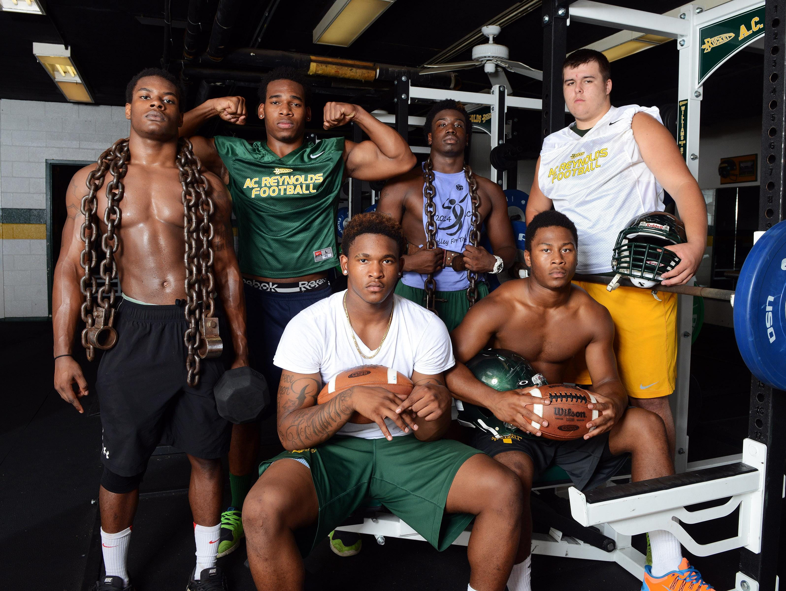 From left to right, Reynolds football players Deshawn Finley, Najae Buchanan, Rico Dowdle, Aundreas Hill, Antonio Logan and Tyler McLaughlin.
