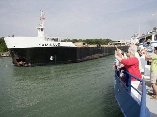 The Keweenaw Star is passing the Sam Laud in the Rock Cut, the downbound channel of the St. Mary's River in the Upper Peninsula in 2011.