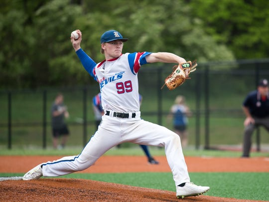 Reading's Logan Barron delivers the game's first pitch