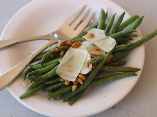 Green beans with anchovies, Parmesan and pine nuts.