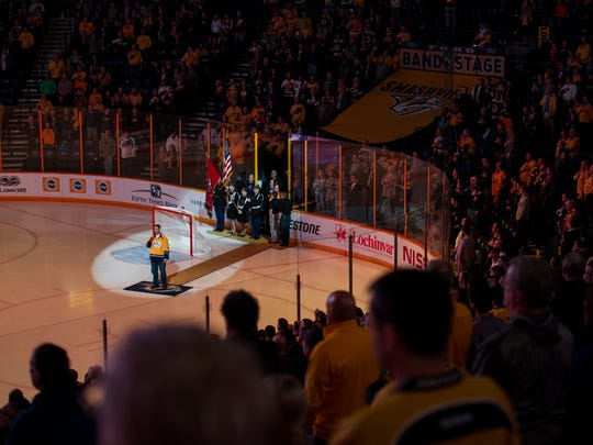 Dennis K. Morgan sings the national anthem before the Nashville Predators game at Bridgestone Arena on Jan. 12, 2017. A Texas native, Morgan has sung the anthem at least part of each Predators season since he moved to Nashville in 2000 — about 165 times total.