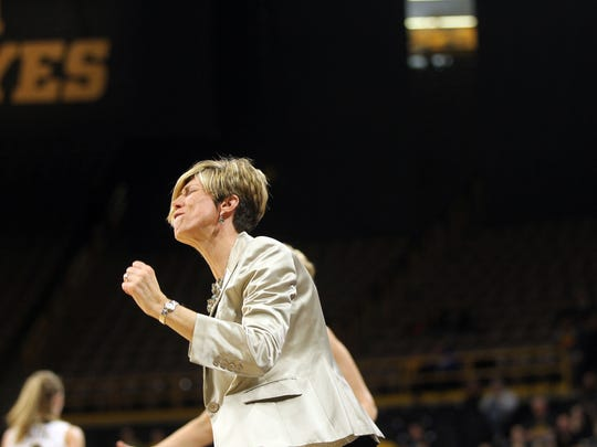 Iowa associate head coach Jan Jensen reacts to a call during the Hawkeyes' WNIT Elite Eight game against Washington State at Carver-Hawkeyes Arena on Sunday, March 26, 2017.