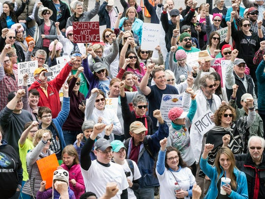 Raised fists of defiance were a regular sight during the Louisville March for Science on Sunday. 4/23/17