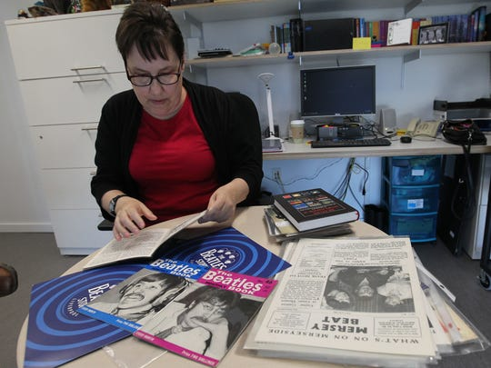 University of Iowa music professor Donna Parsons sorts