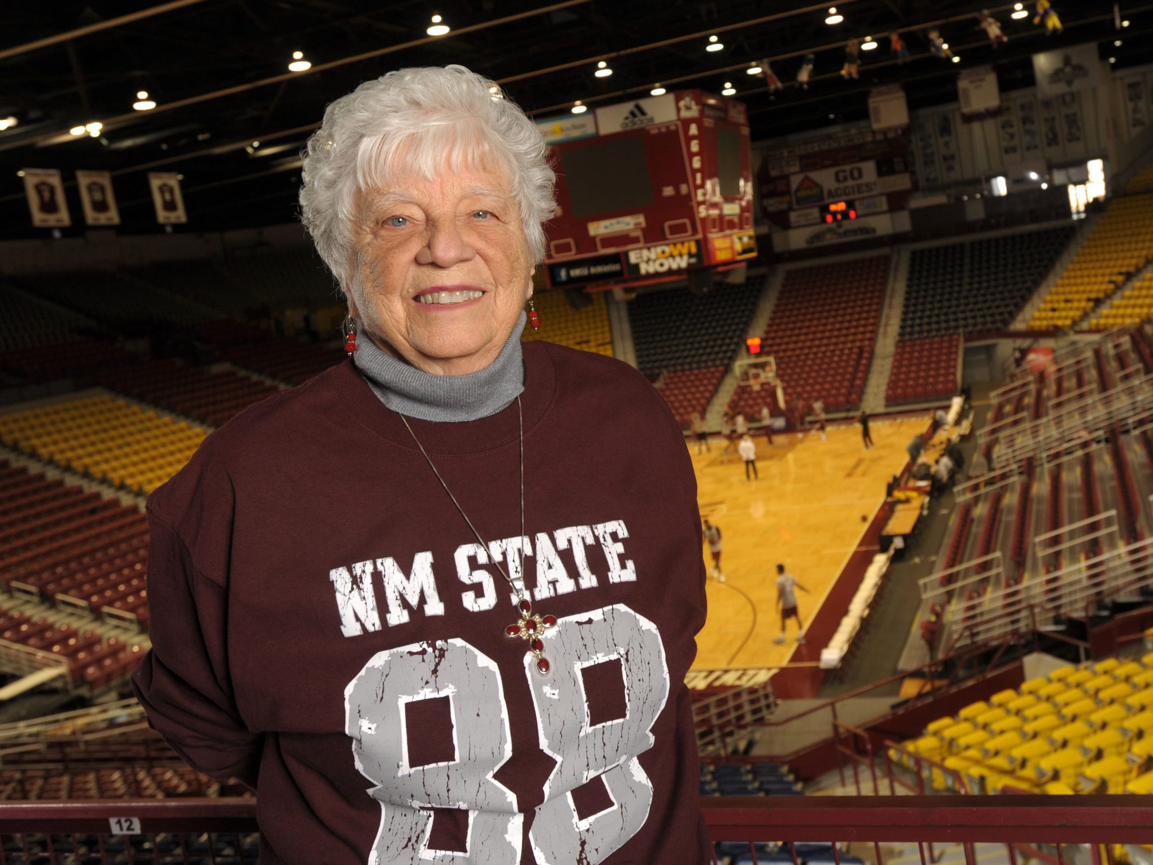 "Barbara Hubbard stands in Pan Am Center at New Mexico State University. ""Mother Hubbard"" became NMSU's first female business manager in 1968. She eventually became director of special events and retired from that position in 1996."