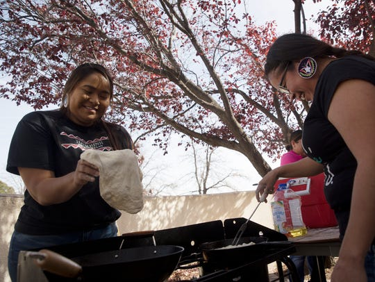 All Nations Leadership Association members Chantelle John, left, and Verrona Cardinal prepare fry bread Monday during a stew and fry bread sale at San Juan College Native American Center in Farmington.