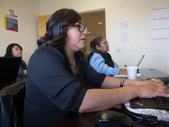 Student Maris Roe takes notes Wednesday during Navajo Court Transcription and Interpretation Program class at Navajo Technical University in Crownpoint.
