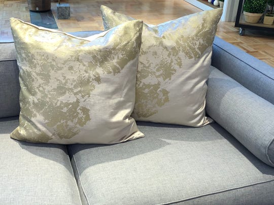 Velvet metallic pillow in stone from West Elm