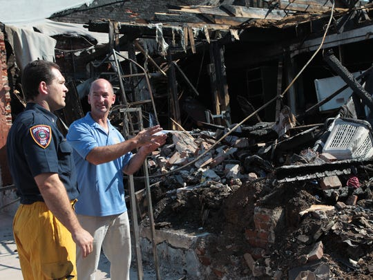 Redding Fire Prevention Inspector Craig Wittner, left, talks with Canteca Foods Inc. owner Stephen Will, in July 2012 at the business that was gutted by a fire.