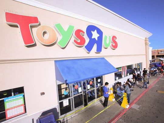 "Shoppers line up outside Toys ""R"" Us in Corpus Christi,"