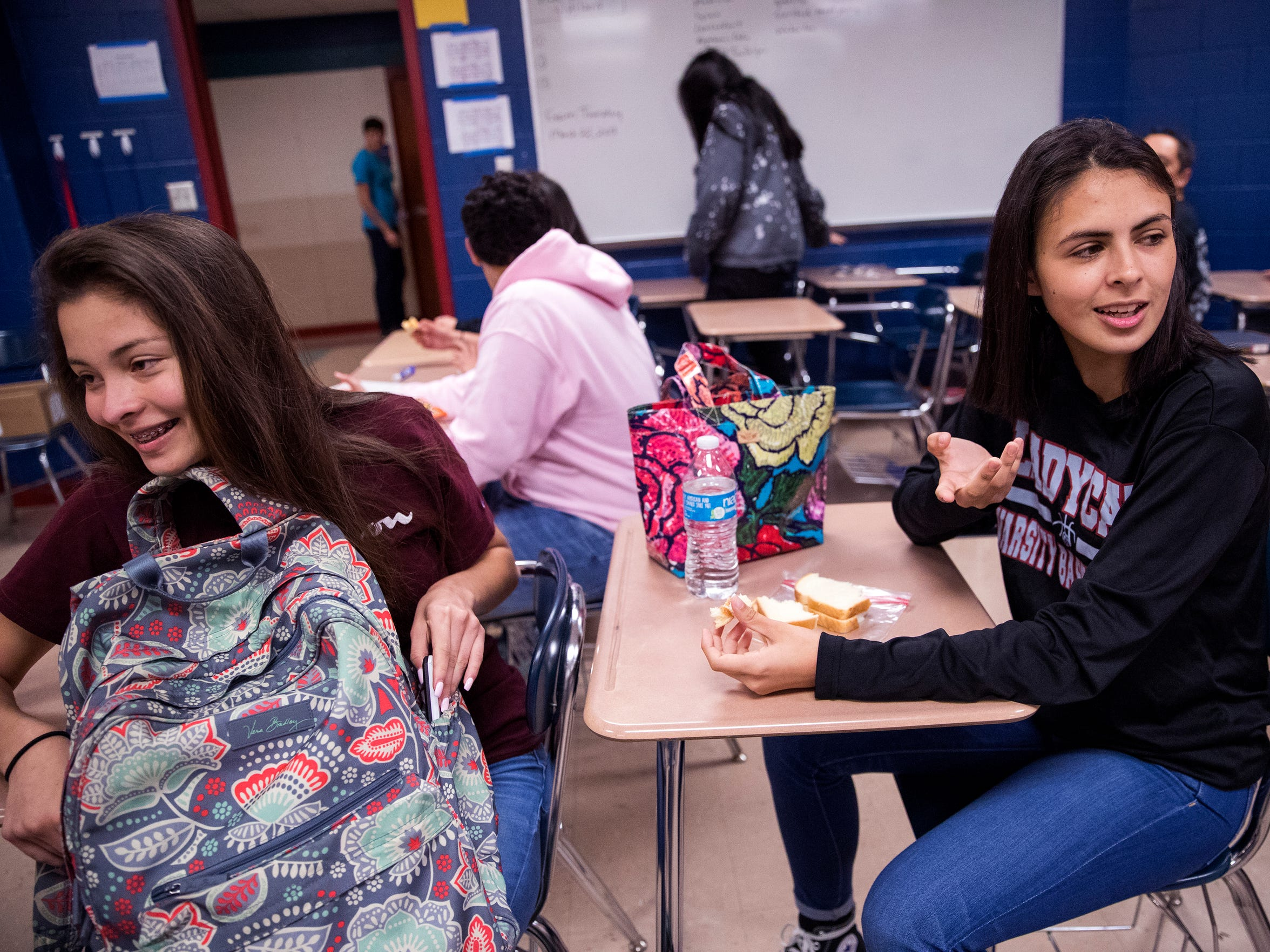 Arleth Flores, 15, and Jessica Hernandez, 16, eat lunch in Jessica's favorite teacher's classroom at Gregory-Portland High School on March 21, 2018. Jessica lived her whole life in Rockport, but when Hurricane Harvey destroyed the apartment she had just moved into with her mom and sister, she didn't have any other choice but to move.