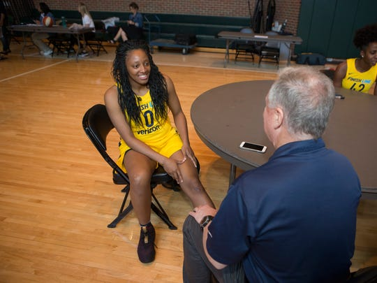 Indiana Fever player Kelsey Mitchell is interviewed by Star reporter David Woods