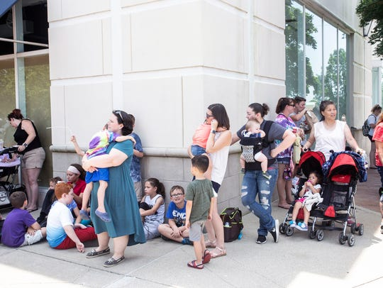 Build-A-Bear customers take refuge in the little shade