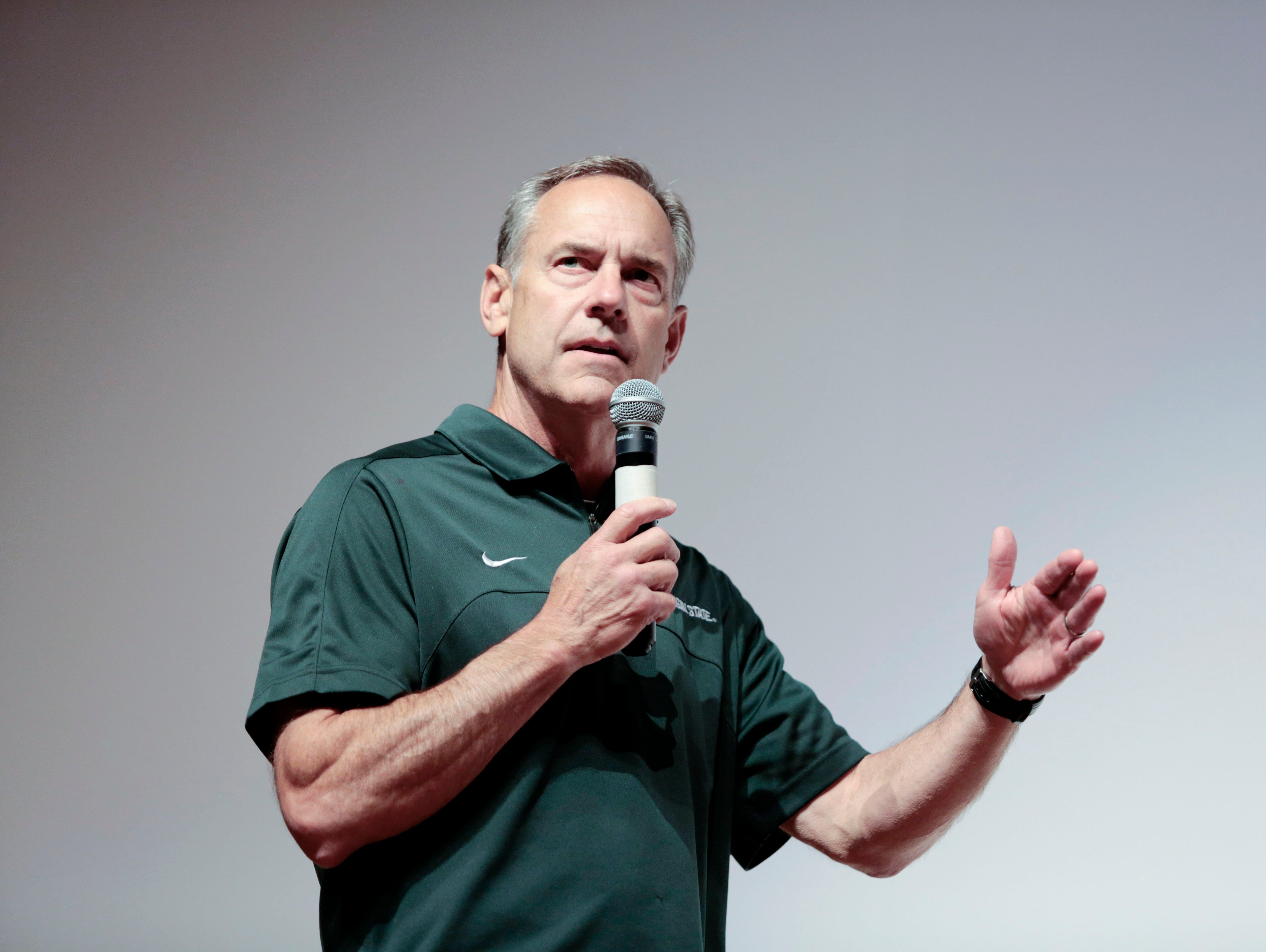 Michigan State football coach Mark Dantonio speaks to the athletes at the Sound Mind Sound Body football camp June 12, 2015, at Dakota High School in Macomb.