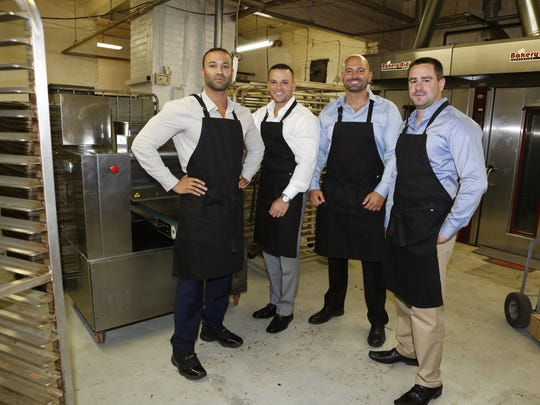 Cookie Republic co-founders from left, White Plains firefighters Sunny Seward, Tonin Bucaj, business manager and Tonin's brother Mark Bucaj and Fairview firefighter Dominick Lombardo are photographed in the kitchen they use to bake in the Bronx.