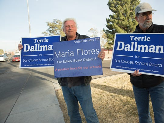 Glenn Landers, left, and Jeff Dallman, right, stand in front of Branigan Memorial Library Tuesday February 7, 2017, supporting Terrie Dallman and Maria Flores for school board.