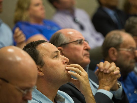 Ross Marks, a college assistant professor with the Creative Media Institute at New Mexico State University, listens to a presentation about the proposed 6 percent tuition-and-fee increase, during the NMSU Board of Regents meeting, Monday June 12, 2017. Marks encouraged the regents to vote for the increase during  public comments at the beginning of the meeting. The regents ultimately voted in favor of the proposal.