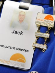 Jack Russell's name tag and pin reflect his commitment