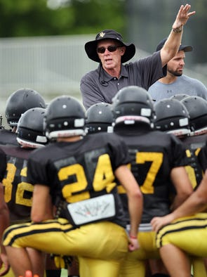 Bishop Verot High School head football coach Bill Shields leads practice Wednesday at Bishop Verot in Fort Myers.