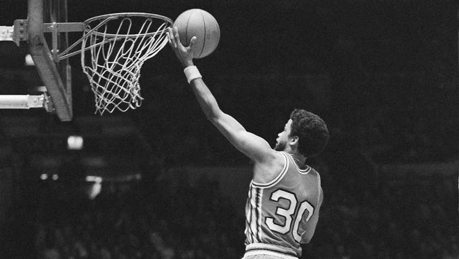 Rutgers' Eddie Jordan goes to score over Bill Rose of Long Island University during their 1976 game at Madison Square Garden in New York.