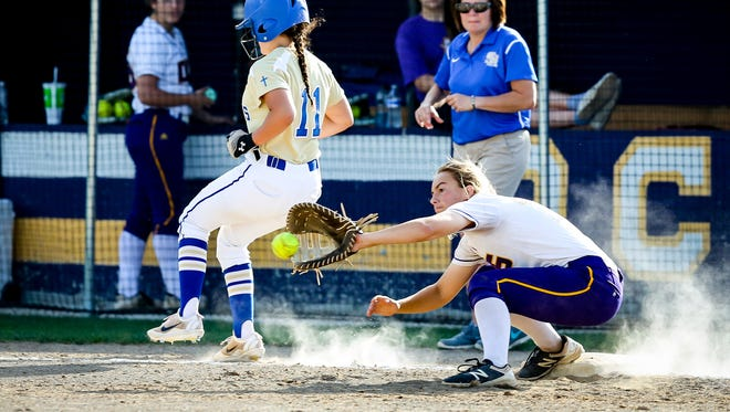 Opelousas Catholic first baseman Mallory Little receives the throw too late as the Sacred Heart Ville Platte baserunner is called safe during their game on Tuesday.