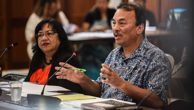 John Camacho, Department of Revenue and Taxation director, responds to a question from Vice Speaker Therese Terlaje, as he testifies along with Deputy Director Marie Benito, during the agency's budget hearing before lawmakers at the Guam Legislature on Tuesday, July 11, 2017.