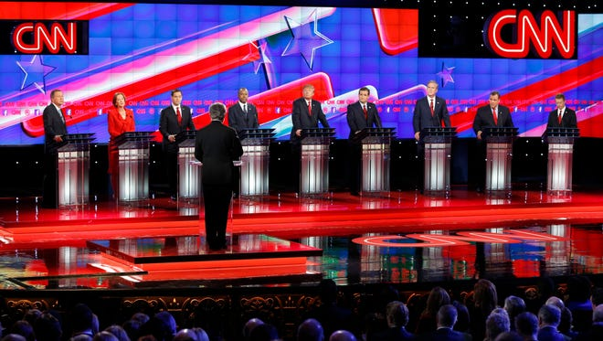 Current and former Republican presidential candidates, from left, John Kasich, Carly Fiorina, Marco Rubio, Ben Carson, Donald Trump, Ted Cruz, Jeb Bush, Chris Christie, and Rand Paul share the stage with CNN's Wolf Blitzer during a presidential debate at the Venetian Hotel & Casino in Las Vegas.