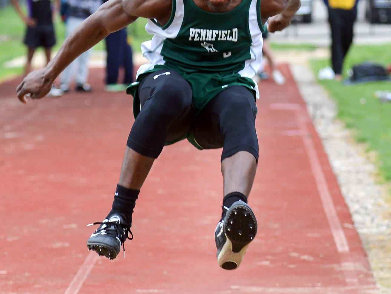 Parris Bolden of Pennfield participates in the long jump during the 2016 All City track meet held at Harper Creek High School Friday evening.