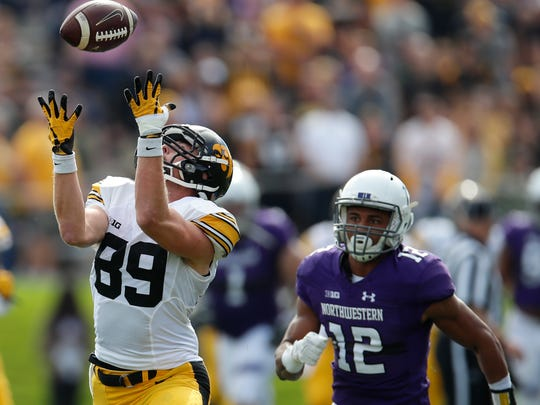 Iowa's Matt VandeBerg makes a 61-yard catch against Northwestern's Alonzo Mayo to set up the Hawkeyes' only touchdown.