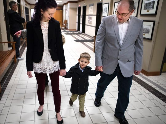 Thu., Jan. 25, 2018: Cameron Knight, city hall reporter at The Enquirer, and his wife, Jennifer Knight, walk with Lucas, 2, into Hamilton County Judge Ralph Winkler's courtroom. The Enquirer/Carrie Cochran