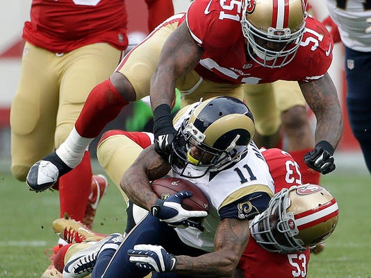 St. Louis Rams wide receiver Tavon Austin (11) is tackled by San Francisco 49ers linebacker NaVorro Bowman (53) and middle linebacker Gerald Hodges (51) during the first half of an NFL football game in Santa Clara, Calif., Sunday, Jan. 3, 2016. (AP Photo/Marcio Jose Sanchez)