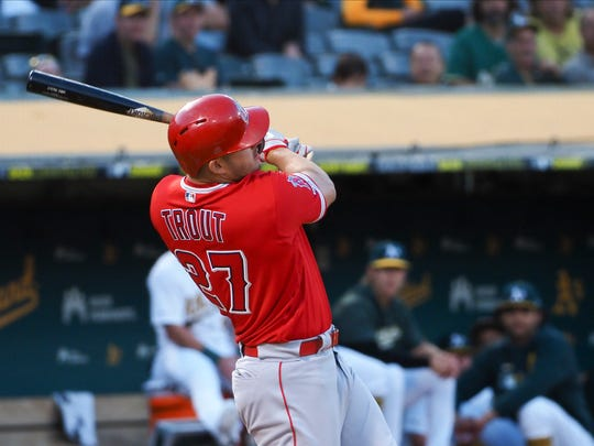 Sep 3, 2019; Oakland, CA, USA; Los Angeles Angels center fielder Mike Trout (27) hits a home run against the Oakland Athletics during the first inning at Oakland Coliseum. Mandatory Credit: Kelley L Cox-USA TODAY Sports