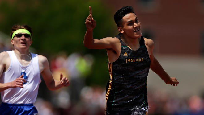 At right, Ashwaubenon's Jose Guzman celebrates as he crosses the finish line to win the Div. 1 400-meter dash during the WIAA state track and field meet at Veterans Memorial Field Sports Complex in La Crosse, Wis., on Saturday, June 4, 2016.