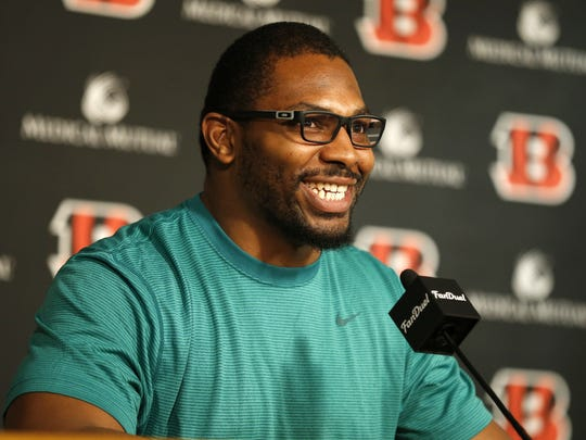 Cincinnati Bengals linebacker Vincent Rey talks in a press conference after signing his new contract at Paul Brown Stadium in downtown Cincinnati, on Thursday, March 10, 2016.