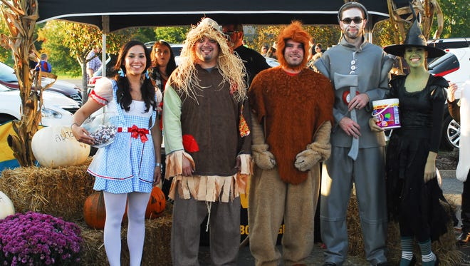 Rachel Serfass, Kyle Peacock, Derek Daniels, Spencer Phillips and Kayla Williams with ABRA Auto Body & Glass Repair smile before Newton Nissan's Trunk or Treat in 2014.