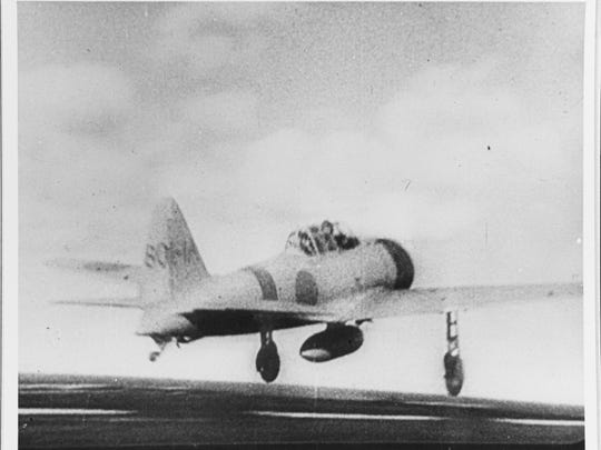 A Japanese Navy Zero fighter takes off from the aircraft