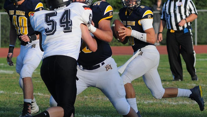 Erie Mason quarterback Noah Beaudrie rolls out against Summerfield in the season opener last season. The teams will open against each other again Friday night, but it will be a Tri-County Conference game this year.
