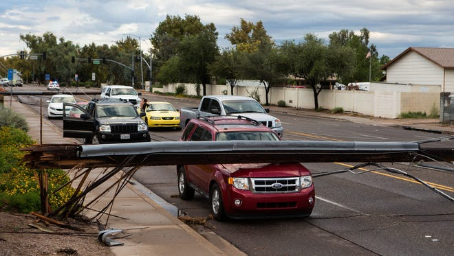 Some motorists were trapped by downed light poles for nearly 3 hours after the recent storm near 59th Avenue and Greenway Road Saturday, September 27 in Phoenix.