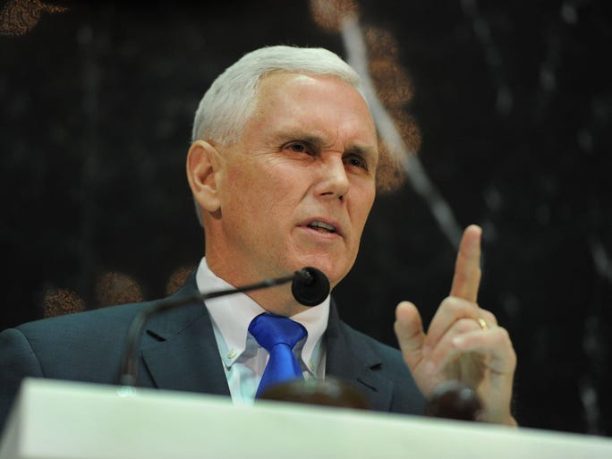 Indiana Governor Mike Pence makes a point at the 2014 State of the State Address in the House Chamber at the Indiana Statehouse Tuesday January 14, 2014.