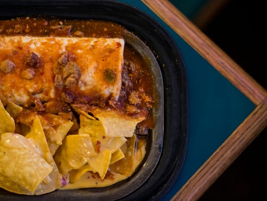 The green chili beef and bean burrito with queso chips,