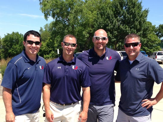 Urbandale High School Associate Principal Tim Carver, physical education teacher and head football coach Sam Anderson, middle school American history teacher and high school football and track coach Tim TeBrink and Urbandale High School resource officer Matt Flattery stand together during the Brad Peyton Memorial Golf Tournament June 27 in Urbandale.