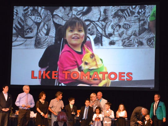"The Ramon Alternative Center Home School team receives the award for ""Outstanding Achievement and Best Personal Narrative"" for ""Like Tomatoes."""