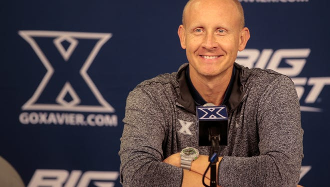 Xavier university head basketball coach Chris Mack takes questions from the media, Wednesday, Nov. 2, 2016, at Xavier University's Cintas Center in Cincinnati.