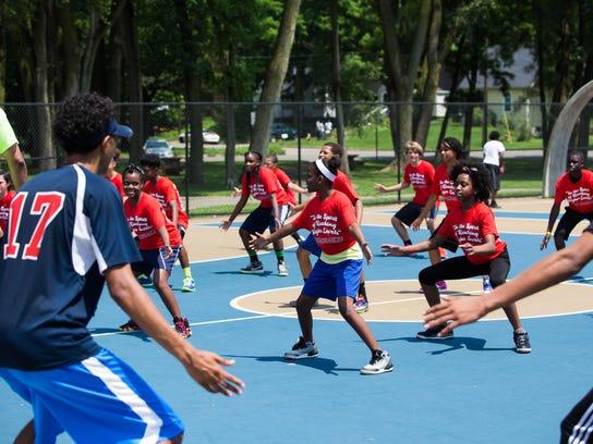 Participants practice their defensive techniques for