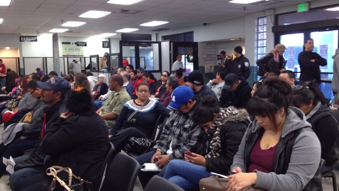 Wait times exceeded two hours at the Indio DMV office on Jan. 2, the first day that state Assembly Bill 60 went into effect, allowing undocumented residents to apply for licenses.