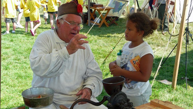 Ken Altergott of Oconto talks with a child during the Annual National Meeting of the Lewis and Clark Trail Heritage Foundation held in Omaha in August 2011. He will speak at the Nov. 1 Oconto County Historical Society Speaker Series.