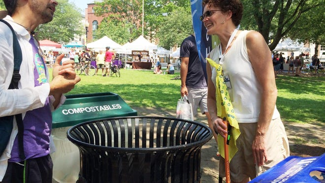 Waste Warrior: Robin Orr, right, an events outreach specialist with Chittenden Solid Waste District, last weekend advises visitors at the Burlington Farmers Market on where to pitch various materials.