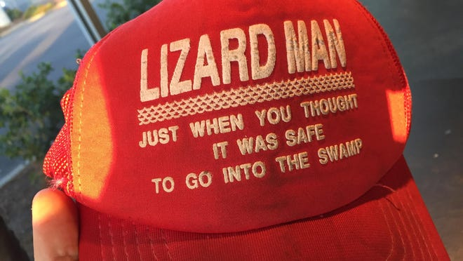 Baseball caps such as this, T-shirts and green-tinted lemonade called Lizard Juice were sold along the side of the road in Lee County when the tale of the Lizard Man spread in 1988.